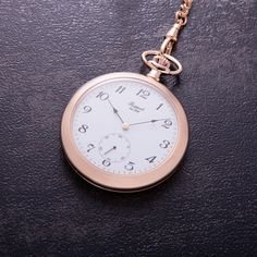 This Open Face Pocket Watch has been crafted with a white dial and an inset second hand. The timepiece features a 17 jewel, mechanical movement in a rose gold plated . Open Face, Popular Mens Fashion, A 17, Rose Gold Plates, Pocket Watch, Women's Accessories, Manual, Jewels, Watches