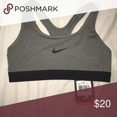 NEW WITH TAGS grey nike sports bra super cozy, getting rid of because I already have the same one. Nike Intimates & Sleepwear Bras