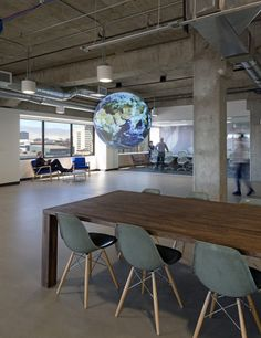 """Studio O+A has recently completed the design of San Francisco-based climate data company, The Climate Corporation. The new office features elegant features mixed with modern styling – and of course an epic video globe.  """"The wide windows of Climate Corporation's headquarters, located on the 11th floor an office building in downtown San Francisco, afford a view of the city that stretches in one direction all the way to the Bay and in the other over hills leading off to the Mission District."""
