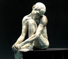 """Man, Head on Knee-Large (detail) , 26""""H, raku-fired stoneware"""