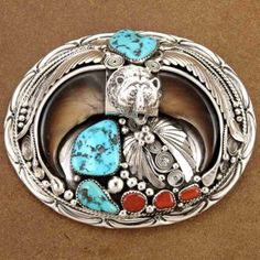 Vintage Navajo Turquoise Coral and Double Bear Claw Sterling Belt Buckle Leland Yazzie http://www.nativeamericanstuff.net/Navajo%20Handcrafted%20Belt%20Buckles%20page-2.htm