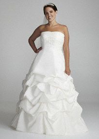 This gorgeous gown captures the overall look of alluring romance and striking beauty! Strapless taffeta ball gown features fabulous lace and beaded detail on bust. Breathtaking full pick up skirt adds drama to this already sensational gown. Chapel train. Available in Ivory. Fully lined. Back zip. Imported polyester. Dry clean. Also available in missy sizes as Style OP9102Train that extends one and a third yards (about 4 feet) from the waist.The ball gown is a classic shape with a fitted…