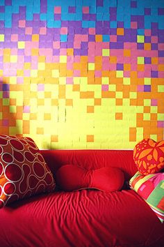 Who knew you could use Post-Its for something other than study notes or marking pages??  These popular paper squares can also be used to create wallpaper, as shown in the dorm room above.