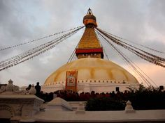 On Christmas Eve in 2008, I watched the sunset at Boudhanath in Kathmandu, while hundreds of red-cloaked Buddhist monks chanted evening prayers and others circumambulated the stupa in silent meditation. In a café overlooking the scene, my partner and I sipped hot coffee and chatted with a group of monks-in-training, who had come down to the city from a monastery in the Himalayas to indulge in earthly pleasures: beer, rum, coffee, and cigarettes. (Click the photo to read the full story.)