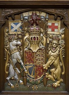 The Royal Arms of Scotland,  Sovereign's stall in the Thistle Chapel of St Giles' Cathedral, Edinburgh. The motto, in Scots, appears above the crest, in the tradition of Scottish heraldry, and is an abbreviated form of the full motto: God Me Defend.