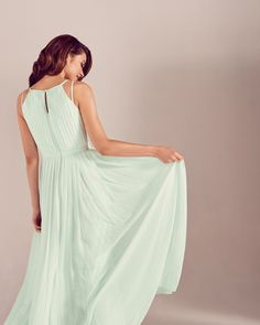 SUMMER WEDDING: A gorgeous mint green bridesmaid dress is the perfect colour choice for a Summer wedding. The Ceryee dress is a floaty pretty piece that features a delicate pleated design and keyhole neck detail that's perfect for dancing the night in on your wedding day.