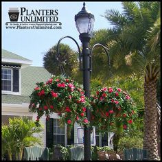 Two-Way Hook Style Hanging Basket Bracket $195.85. This source has commercial-size planters