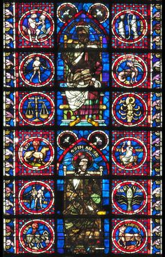 Zodiac signs on a stained glass window of Soisson Cathedral, France