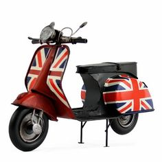 UNION JACK VESPA METAL MODEL  This metal model is an exact replica of the Vespa  motorcycle and it is created with exact scale and details. This metal craft be created by union jack pattern design .this is not toy. This model can serve as an ornament for the house.