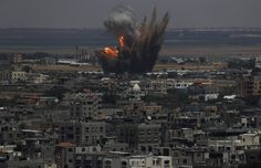 Smoke and flames are seen following what police said was an Israeli air strike in Rafah in the southern Gaza Strip July 8, 2014. Israel bombarded dozens of targets in the Gaza Strip on Tuesday, stepping up what it said might become a long-term offensive against Islamist Hamas after a surge in Palestinian rocket attacks on Israeli towns.