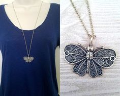 Necklace details:  • Pendant is antique silver-colored butterfly made of zinc alloy metal • Pendant is 1.25 in height and 1.5 in width • Chain is antique silver-plated tiny flat soldered cable chain 2x1.4mm • Necklace is 30 with 2 extender chain and lobster clasp closure • Lead safe, nickel safe • Base metal of chain is brass  Other information:  • Every purchase from our shop supports nature-related organizations • This necklace is part of our Into the Woods collection, and supports…