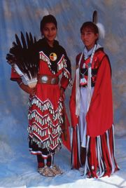 Vickie Summers (left)  Southwold, Ontario, Canada  Iroquois tribe - Oneida nation  Women's Jingle Dancer.Sandra Elm (right)  Southwold, Ontario, Canada  Iroquois tribe - Oneida nation  Women's Fancy Shawl Dancer