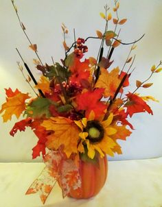 Features:  -Ceramic pumpkin container.  -Poly-silk maple leaves, sunflowers, berry sprays and natural pencil cattails.  -Indoor use.  -Hand made.  -Product may vary from photo as each is hand made.  -