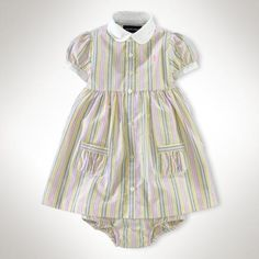 This striped shirtdress, made from traditional oxford cotton, features pretty puffed sleeves and a sweet collar. Club collar. Applied placket. Short puffed sleeves. Patch pockets at the... More Details