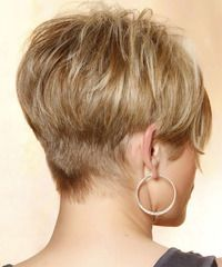 The back of this do is clipper cut then graduated up to the crown and sides with jagged cut layers blending into the top. The crown is styled with height and lift making a fab 'do to balance out a round face. Cute!