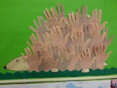 'The Hodgeheg' classroom display - predictions about book written on hands.