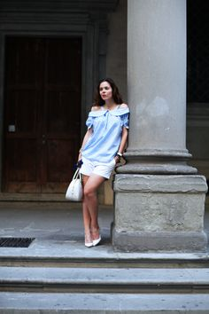 Pale blue and white is the perfect summer colour combination - tailored shorts and an off the shoulder blouse make for a chic daytime look