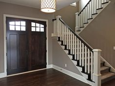 dark wood double front entryway doors