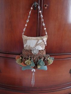 Pillow tassels to hang on doors or furniture...awesome! http://www.etsy.com/listing/53547354/the-butterfly-ballet
