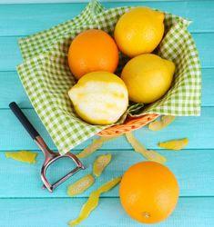 Lemons and oranges on napkin in basket and peeling knife on blue wooden background Wooden Background, Plastic Cutting Board, Basket, Food, 5 Ways, Napkin, Gardening, Blue, Essen