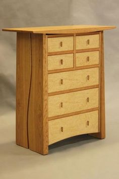 Cherry and birdseye maple chest of drawers.