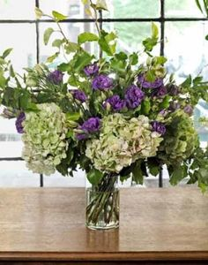 """Why bother with floral foam or marbles when the best arranging tool is right in your backyard? """"You can use tree branches to form a backbone that will support more delicate stems,"""" says florist Felipe Sastre. Here, Sastre crisscrossed six pear boughs and weaved in hydrangea and lisianthus, as well as lady's mantle. If your branches are alive and leafy like these, scrape the bottoms, then split them up the center a couple of inches to aid water absorption."""