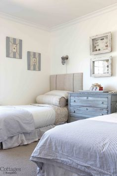 This bright bedroom gives off the air of a beach-side cottage. With linen headboards and striped bedspreads, the nautical theme is carried throughout the room. A faded blue dresser and distressed frames complete the cottage bedroom.