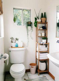 organized bathroom shelf from ikea, white towels, plants