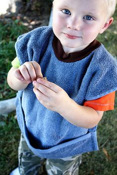 Tutorial: Sleeved Toddler Bib....great steps on applying a knit neck hole