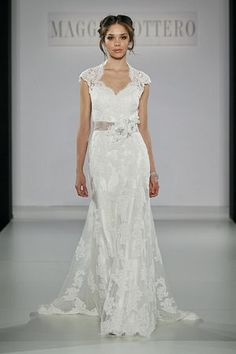 this dress has the top of the wedding dress design ... in ecru not white ... with a bling belt.