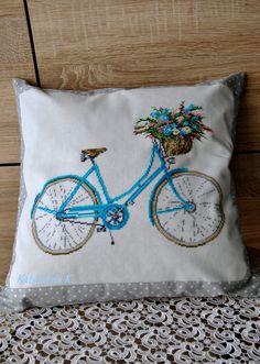 Retro bike cross stitch on a pillow