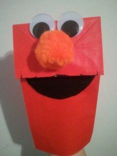 Elmo Paper Bag Puppet:  Paper bag  Wiggle Eyes  Orange pom pom nose  Black felt mouth, top lip outlined with marker!  Craft for kids to make at birthday party!