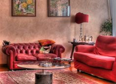 Charming Red Sofas for Gorgeous Living Room: Modern Living Room With Red Table Lamp And Red SOfas