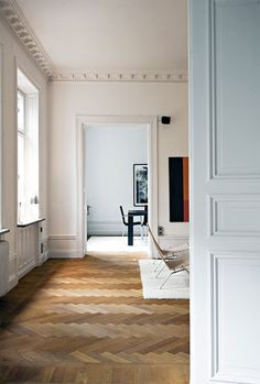 I love that french way of rooms flowing into each other rather than running off a corridor. herringbone floor heaven.