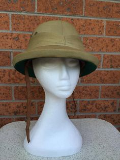 This fine vintage Bombay Bowler pith helmet is really tops. It was made in India from genuine pith, and features a vinyl hatband and leather chin