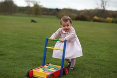 Princess Charlotte in one of her first birthday portraits taken by her mom Princess Kate, Duchess of Cambridge
