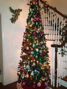 Family memories Christmas tree!  Glass blown ornaments are added each year to reflect a significant event that occurred during the past year..wedding, graduation, new job, family vacation etc!