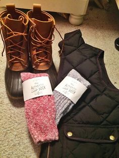 these are all from j crew and I love their puffer vests camp socks!!!! totally recommend them to yall! perf for boots !