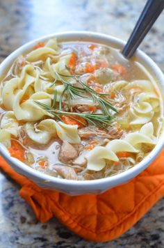 Slow Cooker Chicken Noodle Soup with white wine and rosemary. This is hands down the best chicken noodle soup.