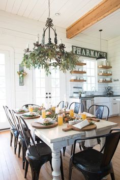 (Support beam visible but not unattractive in ceiling with raised ceilings on either side) plus Dinner party ideas by Joanna Gaines
