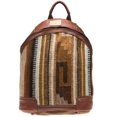 Oaxacan Dome Backpack - The Zapotec people of Oaxaca, Mexico have a weaving tradition that is seventeen centuries old. When Conquistadors introduced sheep and looms, the process and materials changed, but the intrinsic bold geometry and nature-hewn colors carried on to the present day.  Our Oaxacan Collection is created using hand-loomed wool rugs which are strengthened by leather panels that direct weight and wear away from the fabric to ensure these usable works of art serve you beautifully for years to come...