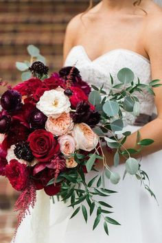 Fall wedding bouquet idea - burgundy + red wedding bouquet - lush bouquet with roses, ranunculuses, astilbe, and greenery {Sarah Bradshaw Photography}