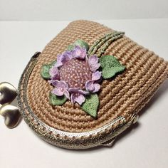 Beige crochet coin purse with crocheted and hand painted