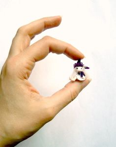 Tiny purple fairy - Amy, the crocus pixie. $34.00, via Etsy.  Oh my GOD. I *must* own this!