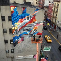"""Just had to getter a better view of this insane mural in progress by Tristan Eaton! @thelisaprojectnyc @wixlounge @secretwalls @terrymonorex #epic…"""