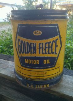 Early Golden Fleece service station motor oil can with timber handle