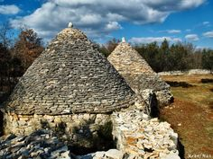 'Kažuni' in Istria, #Croatia Little stone huts of circular ground plans and conical roofs.  They are scattered round the fields and can still be useful as protection from unexpected showers, for laying away farming tools but also for night watching of the crops against the evil chance travellers. 'Kažun' is a type of building the existence of which has been recorded all over the #Mediterranean since 4000 years B.C.