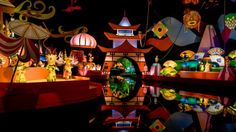 Brightly costumed dolls representing Japan and Mexico in scenery from their lands at 'it's a small world'