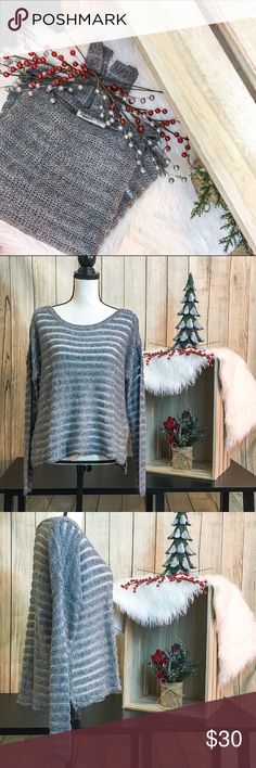 NWOT. Silver and Gray Sweater 🎄Gray and silver see-thru sweater 🎄Slouchy and very stretchy  🎄Side Slits 🎄Easily snags (small ones shown in photo) 🎄Size M/L  🐘BUST: 48in 🐘SLEEVES: 33in 🐘LENGTH: 20in 🐘58% Cotton 25% Acrylic 15% Polyester 2% other fibers  💋DISCLAIMER💋 - Reasonable offers accepted on items not marked 'price firm' - 15% off on bundles of 2 or more items - I do not discuss prices in the comments, but feel free to ask any other questions🙂 Hollister Sweaters Crew & Scoop…