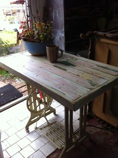 Handy little table made from old sewing machine base and wood from the walls of an 80 + year old house.